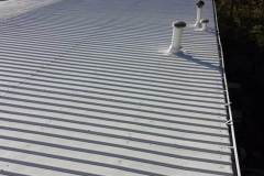 Standing seam metal roof with vents